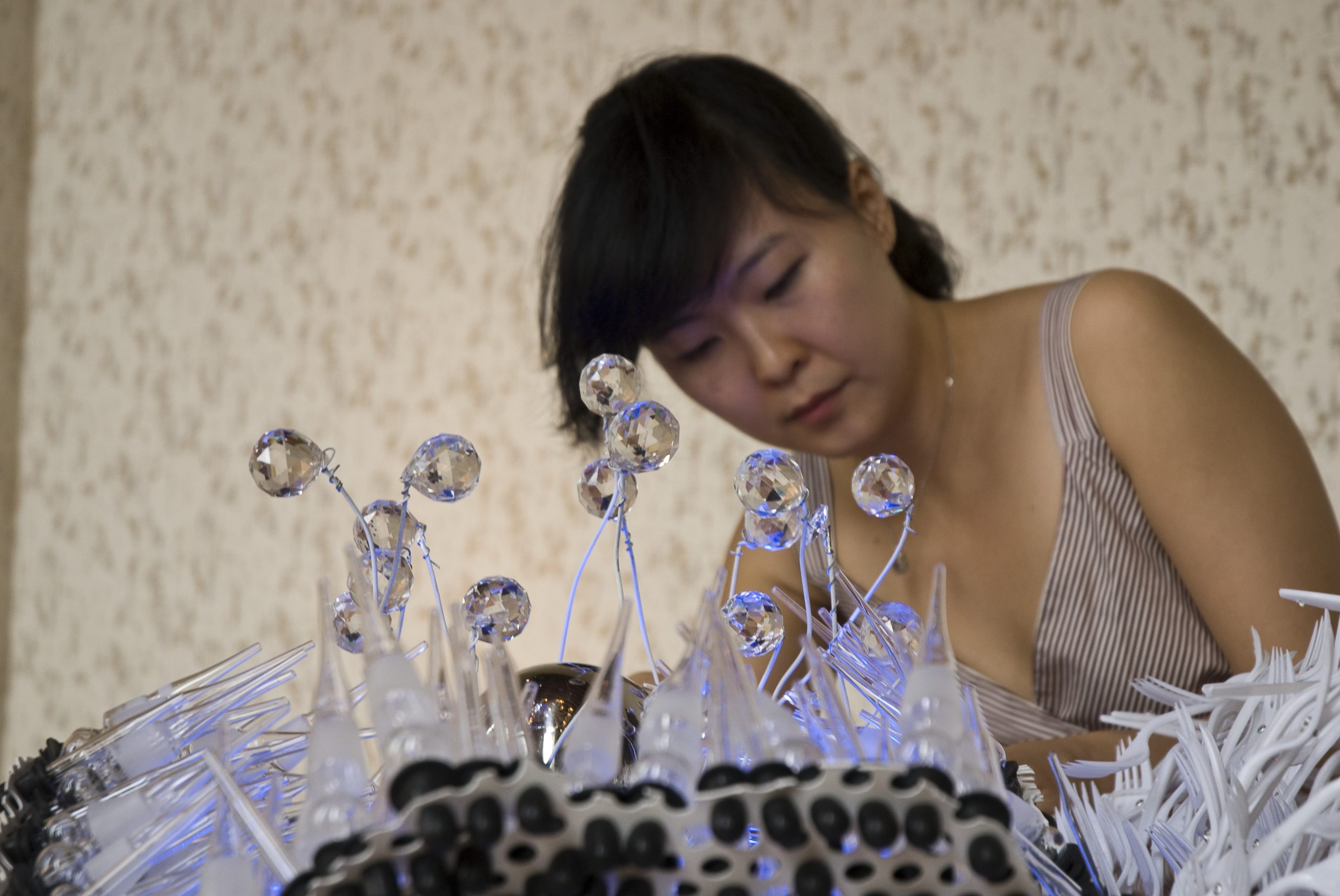 Soyeon Cho installing his work at Glasstress 2009